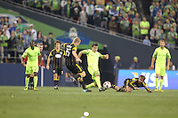 Nathan Sturgis (12)of the Seattle Sounders FC runs past Kevin Burns (15) of the  Columbus Crew . The Seattle Sounders FC defeated the Columbus Crew 2-1 during the US Open Cup Final at Qwest Field in Seattle,WA, on October 5, 2010.