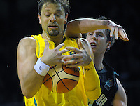 David Anderson takes a rebound during the FIBA Oceania men's tournament basketball match between New Zealand and Australia at TSB Bank Arena, Wellington, New Zealand on Tuesday, 18 August 2015. Photo: Dave Lintott / lintottphoto.co.nz