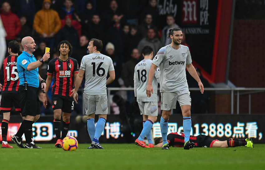 West Ham United's Andy Carroll (right) is shown a yellow card by Simon Hooper<br /> <br /> Photographer David Horton/CameraSport<br /> <br /> The Premier League - Bournemouth v West Ham United - Saturday 19 January 2019 - Vitality Stadium - Bournemouth<br /> <br /> World Copyright © 2019 CameraSport. All rights reserved. 43 Linden Ave. Countesthorpe. Leicester. England. LE8 5PG - Tel: +44 (0) 116 277 4147 - admin@camerasport.com - www.camerasport.com
