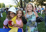 Trying out the JCP&L Hard Hat and lineman protective gear are sisters (L to R) Toni Marie (8), Jordyn (5) and Gabriella Taylor (9) of Brick, New Jersey at the National Night Out in Long Branch, New Jersey on Tuesday August 2, 2016.<br /> <br /> <br /> MODEL RELEASE SIGNED