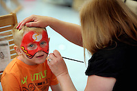 Rio Alvis, 5 has his face painted