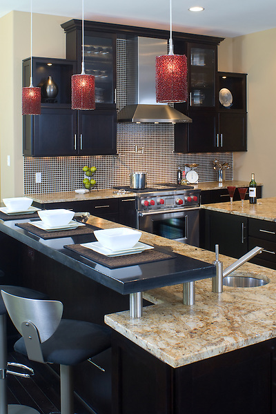 Modern kitchen design with a polished concrete breakfast bar.