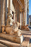 Lions with Atlas on their back holding up a column that supports the canopy above the main portal of the 12th century Romanesque Ferrara Duomo, Italy