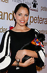 LOS ANGELES, CA. - October 22: Actress Susie Castillo and dog Oscar arrive at the Peter Alexander Flagship Boutique Grand Opening And Benefit on October 22, 2008 in Los Angeles, California.