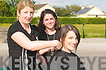 HAIR: Caitriona Walsh of Abbeydorney having her hair cut for charity by Margaret Boyle and Noelle Collins outside Wave Lenghts Hair Salon, Ardfert, on Thursday last..