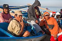 Jimbaran, Bali, Indonesia.  Balinese Fishermen Relaxing on the Beach, Early Morning.
