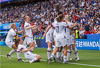 PARIS,  - JUNE 28: Teammates celebrate the goal of Megan Rapinoe #15 during a game between France and USWNT at Parc des Princes on June 28, 2019 in Paris, France.