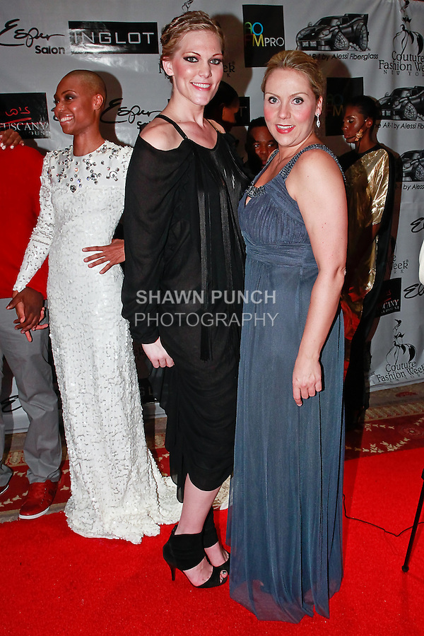 Couture Fashion Week staff Kelsie McKenna (left) poses with Soprano singer Christine Reber (right) on red carpet during Couture Fashion Week Spring 2012, at the Waldorf Astoria-Hotel in New York City.