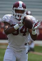 NWA Democrat-Gazette/ANDY SHUPE<br /> Arkansas linebacker Tyler Phillips makes a catch Saturday, Aug. 5, 2017, prior to the start of a scrimmage in Razorback Stadium in Fayetteville. Visit nwadg.com/photos to see more photographs from the practice.
