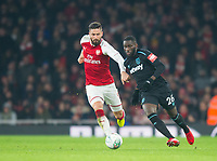 Arsenal's Olivier Giroud  and and West Ham's Arthur Masuaku during the Carabao Cup QF match between Arsenal and West Ham United at the Emirates Stadium, London, England on 19 December 2017. Photo by Andrew Aleksiejczuk / PRiME Media Images.