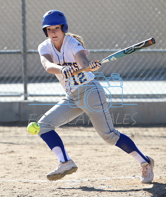 Wildcat Jennie Quam slaps during a college softball game against Salt Lake Community College, on Friday, Feb. 15, 2013, in Carson City, Nev. SLCC won the opener 4-2..Photo by Cathleen Allison