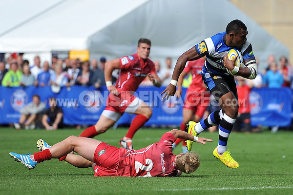 Semesa Rokoduguni takes on the Scarlets defence. Pre-season friendly match, between Bath Rugby and the Scarlets on August 16, 2014 at the Recreation Ground in Bath, England. Photo by: Patrick Khachfe / Onside Images