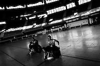 Cristian Amaya and Leonardo Vera, Colombian disabled athletes, take part in a wheelchair rugby training match at the indoor sporting arena Coliseo in Bogota, Colombia, 29 January 2013. Wheelchair rugby, a full-contact team sport, was developed in Canada in 1977 under the name murderball. The game is played only by athletes with some form of disability in both the upper and lower limbs (quadriplegics). Attempting to score by carrying the ball across the goal line, four players from each team roughly crash into each other in specially designed armored wheelchairs. Although the team from Bogota is supported by a foundation (gear), quad rugby players, mostly coming from the remote, socially deprived neighbourhoods, often can not attend a training due to lack of funds for transportation. However, they still dream of representing Colombia at Rio 2016 Paralympic Games.