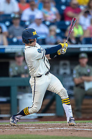 Michigan Wolverines catcher Joe Donovan (0) swings the bat against the Vanderbilt Commodores during Game 1 of the NCAA College World Series Finals on June 24, 2019 at TD Ameritrade Park in Omaha, Nebraska. Michigan defeated Vanderbilt 7-4. (Andrew Woolley/Four Seam Images)