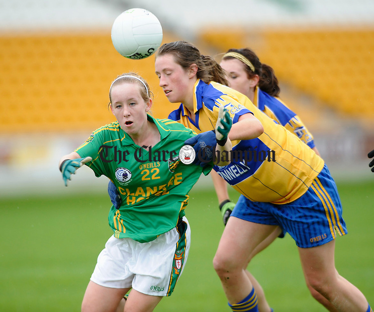 Donegal's Kayla Farren is tackled by Clare's Eimear O Connor during their All-Ireland U-18A Minor championship final at Tullamore. Photograph by John Kelly.