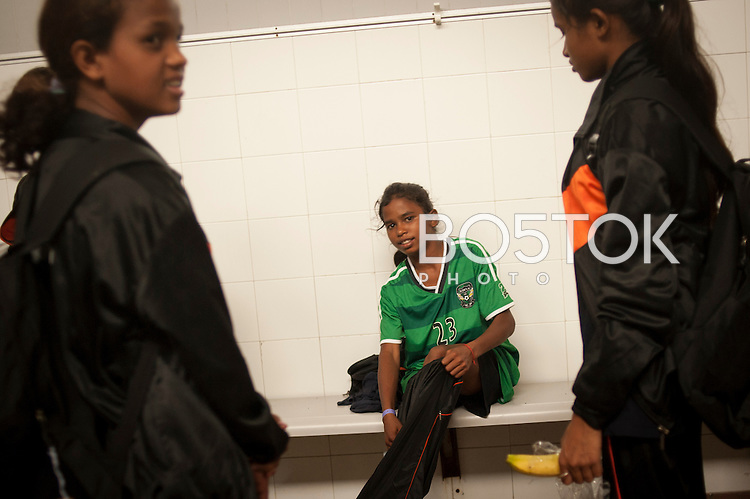 Yuwa team's coach try to console the players after having lost the game against Santa Teresa team. Hernani (Basque Country) 04 July 2013. Yuwa Jharkhand is a program for girls aged 5-17 to promote health, education and improved livelihoods through football. Yuwa team was in Donostia playing Donosti Cup international football tournament (Gari Garaialde/Bostok Photo)