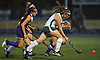 Emiline Biggin #16 of Carle Place, right, moves the ball downfield during the Nassau County varsity field hockey Class C final against Oyster Bay at Adelphi University on Saturday, Oct. 28, 2017. She and teammate Julia Pascarella (not in picture) scored two goals each in Carle Place's 5-0 win.
