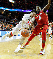 Virginia guard London Perrantes (23) pushes past Maryland forward Charles Mitchell (0) during the game Monday night in Charlottesville, VA. Photo/The Daily Progress/Andrew Shurtleff /