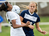 NWA Democrat-Gazette/JASON IVESTER --05/22/2015--<br /> Pulaski Academy sophomore Morgan Wallace (left) and Little Rock Christian junior Kendall Byrd vie for possession in the 5A championship game on Friday, May 22, 2015, at Razorback Field in Fayetteville.
