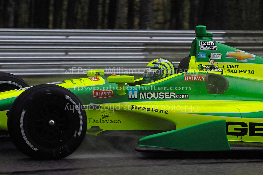 Tony Kanaan (#11)in the rain.