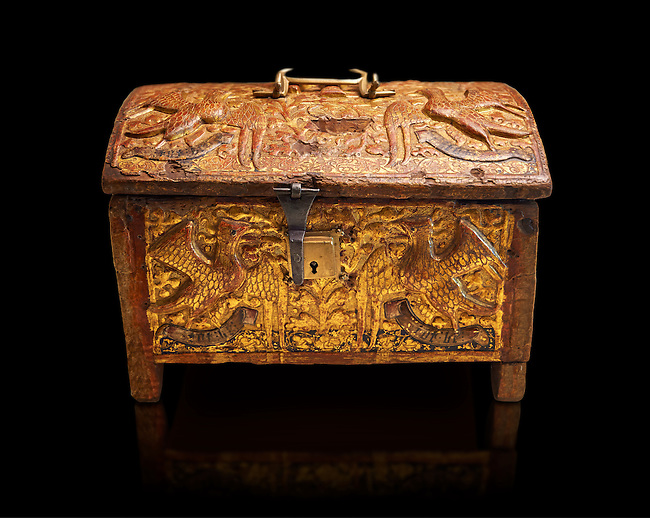 Gothic box made from poplar wood with stucco reliefs, gold leaf gold decorations and traces of polychrome iron and brass 2nd quarter 15th century, possibly from Barcelona, Catalunya, Spain. National Museum of Catalan Art, Barcelona, Spain, inv no: MNAC 12120. Against a black background.