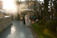 Manar, a Sister, runs towards her new husband from El Rahman El Rahim Mosque where they have just been married. Abbasseya, Cairo, Egypt. July 14th, 2012.