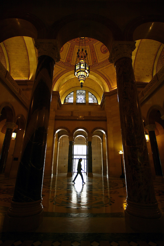 Los Angeles City Hall-- A person walks through the middle of the City Hall rotunda.