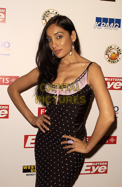 SOFIA HAYAT.The Eastern Eye Asian Business Awards 2006 at the Grovesnor House Hotel in London, UK..April 19, 2006 .Ref: CAN.half length black pink polka dot dress hands on hips.www.capitalpictures.com.sales@capitalpictures.com.© Capital Pictures.