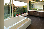 Master bathroom with floor-to-ceiling sliding windows that allow access to flower-filled window boxes. This image is available through an alternate architectural stock image agency, Collinstock located here: http://www.collinstock.com