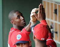 Outfielder Jiwan James (23) of the Lakewood BlueClaws gets a high-five in the dugout after scoring the first run in Game 2 of the South Atlantic League Championship Series against theGreenville Drive on Sept. 14, 2010, at Fluor Field at the West End in Greenville, S.C. Photo by: Tom Priddy/Four Seam Images