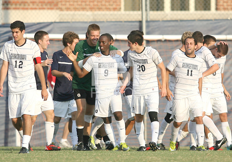 Uche Oteqbeye #9 of Georgetown University after scoring the game winning goal during an NCAA match against Northeastern University at North Kehoe Field, Georgetown University on September 3 2010 in Washington D.C. Georgetown won 2-1 AET.