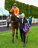 Winner of The Molson Coors Handicap Eye of The Water ridden by David Probert and trained by Ronald Harris  is led into the Winners enclosure during Evening Racing at Salisbury Racecourse on 11th June 2019