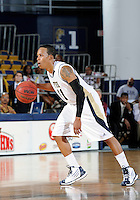 Florida International University guard Phil Taylor (11) plays against Troy University, which won the game 75-70 in overtime on February 23, 2012 at Miami, Florida. .