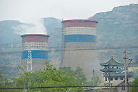 Daytime landscape view from a train of cooling towers and a smokestack at a commercial manufacturing facility near Píngyáo county of the Jìnzhōng District in Shānxī Province, China  © LAN