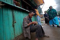 a shoe shiner boy works on a street of the mercato neighborhood in Addis Ababa, Ethiopia on Wednesday August 09 2006..poverty in Mercato is widely spread. fortune seekers land in the nearby bus station, the biggest in the country, and seldom settle in the neighborhood. the high percentage of travelers accentuates the number of sex workers in the area, that sell their bodies for sums as low as 1.5 usd. HIV is a big problem in mercato and many local NGOs support the hundreds of orphans that stayed after their parents died.. Ethiopia is one of the countries most affected by HIV/AIDS. Of its population of 77 million, three million are HIV-positive, according to government statistics. Every day sees 1,000 new infections. A million children under 14 have lost one or both parents to AIDS, and 200,000 children are living with AIDS. That makes Ethiopia the country with the most HIV-positive children..