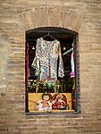 Stop window display, clothing and souvenirs, San Gimignano, Siena-Tuscano, Italy