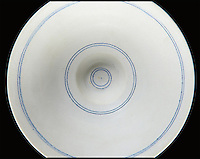 BNPS.co.uk (01202 558833)<br /> Pic: Phillips/BNPS<br /> <br /> It may look like an unassuming white bowl but that didn't stop art collectors going potty over it - paying a record &pound;173,000 for it at auction.<br /> <br /> This humble porcelain bowl with concentric blue lines on the inside was made almost 40 years ago by famed British potter Lucie Rie.<br /> <br /> Seven years after it came out of the kiln it was bought by a private collector who kept it for the next 30 years. It has now sold for a record price for a Rie item.