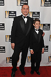 Robert Knepper, left, and son, Ben, arrive at the Creative Coalition Inaugural Ball on Monday Jan. 21, 2013, in Washington. (Photo by Larry French/Invision/AP)