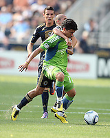 Fred #7 of the Philadelphia Union grabs hold of Fredy Montero #17 of the Seattle Sounders FC during the first MLS match at PPL stadium in Chester, Pa. on June 27 2010. Union won 3-2.