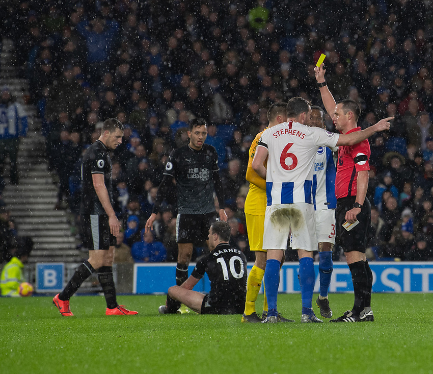 Brighton & Hove Albion's Matthew Ryan is shown a yellow card by Stuart Attwell for a tackle on Burnley's Ashley Barnes resulting in a penalty given to Burnley<br /> <br /> Photographer David Horton/CameraSport<br /> <br /> The Premier League - Brighton and Hove Albion v Burnley - Saturday 9th February 2019 - The Amex Stadium - Brighton<br /> <br /> World Copyright © 2019 CameraSport. All rights reserved. 43 Linden Ave. Countesthorpe. Leicester. England. LE8 5PG - Tel: +44 (0) 116 277 4147 - admin@camerasport.com - www.camerasport.com