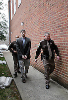 CHARLOTTESVILLE, VA - FEBRUARY 14: George Huguely is escorted to court for his trial in the death of former girlfriend Yeardley Love. Huguely was charged in the May 2010 death of his girlfriend Yeardley Love. She was a member of the Virginia women's lacrosse team. Huguely pleaded not guilty to first-degree murder. (Credit Image: © Andrew Shurtleff