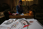 Palestinian artist Najat Abu Yusuf, 20, paints artworks with makeup, at her house in Khan Younis in the southern Gaza strip, on March 19, 2019. Painting with makeup is a fun and cost-effective alternative to exploring your creativity. But professional paints are often expensive, not to mention extra supplies such as paint brushes, palettes, cleaners and thinners. Photo by Ashraf Amra