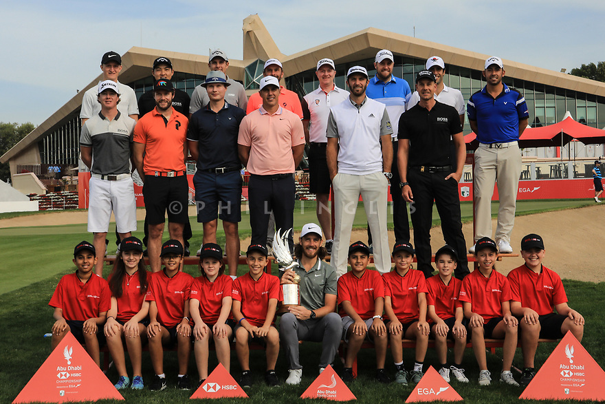Tommy Fleetwood (ENG), last years winner together with other players and local school children gather for a group photograph during previews for the Abu Dhabi HSBC Championship presented by EGA Grand played at Abu Dhabi Golf Club, Abu Dhabi, UAE. 14/01/2019<br /> Picture: Golffile   Phil Inglis<br /> <br /> All photo usage must carry mandatory copyright credit (© Golffile   Phil Inglis)