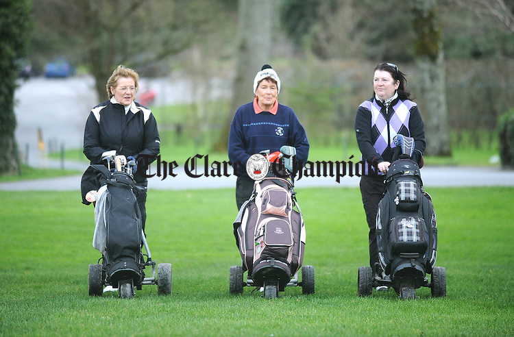 Patricia Woods, Maureen Mc Keogh, lady captain, and Mary Arthur heading out for a round at Dromoland Golf Club. Photograph by Declan Monaghan