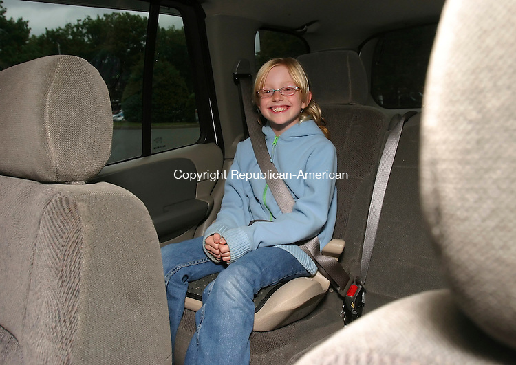 WATERBURY,  CT 26 September 2005 -092605BZ05-  Bridget Erickson, 8, of Cheshire, in a booster seat in the back of her mothers SUV.   <br /> Jamison C. Bazinet / Republican-American