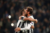 Calcio, Champions League: Gruppo H, Juventus vs Lione. Torino, Juventus Stadium, 2 novembre 2016. <br /> Juventus&rsquo; Gonzalo Higuain, left, celebrates with teammate Claudio Marchisio after scoring on a penalty kick during the Champions League Group H football match between Juventus and Lyon at Turin's Juventus Stadium, 2 November 2016. The game ended 1-1.<br /> UPDATE IMAGES PRESS/Isabella Bonotto