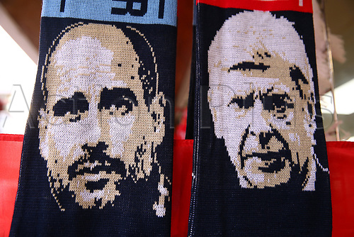 15th March 2018, Emirates Stadium, London, England; UEFA Europa League football, round of 16 second leg, Arsenal versus AC Milan; Arsenal manager Arsene Wenger and Manchester City manager Pep Guardiola on a scarf displayed outside Emirates Stadium before kick off