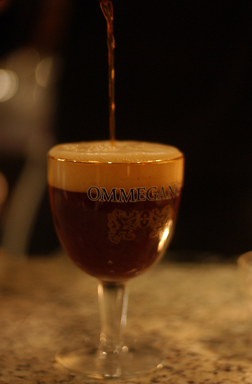 Chef Bart Vandaele pours a Ommegang beer at Belga Cafe on 8th St., SE.