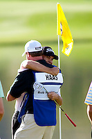 Bill Haas and his caddie embrace after winning the 2010 Bob Hope Classic.