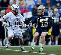 Michael Crimmins (13) of Loyola tries to stop Grant Krebs (12) of Notre Dame during the Face-Off Classic in at M&T Stadium in Baltimore, MD